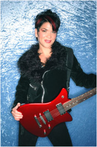 Leslie Stoddard, rhythm and lead guitarist for Gia's Fix with her Farnell Millennium