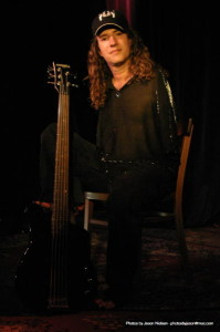 "Mark Goffney, multi-talented bassist/singer with ""Big Toe"" plays an EXB-5 bass with his toes!"