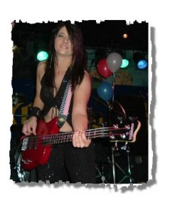Kim Martin, accomplished bassist, singer & recording artist playing one of her EXB-4 Custom Pro series